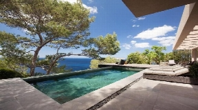 Modern sea facing villa with sunset in Cala Moli for sale